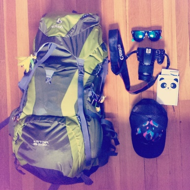 Packed and ready to go: Deuter ACT Lite 45 + 10 SL Pack, hat, sunnies, journal, Canon Rebel XS DSLR.